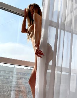 Russian Petite By The Window